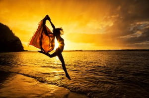 woman_jumping_silhouette_beach_iStock_23130482